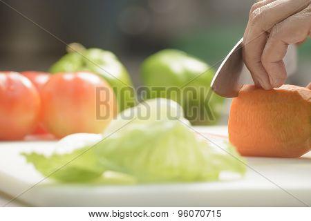 Female Cook Cutting Carrot