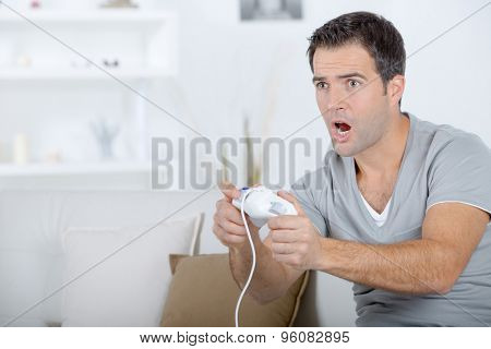 Man playing computer game, excited