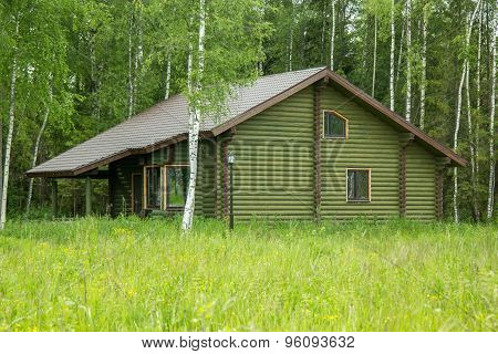 Log House On The Outskirts Of Forest