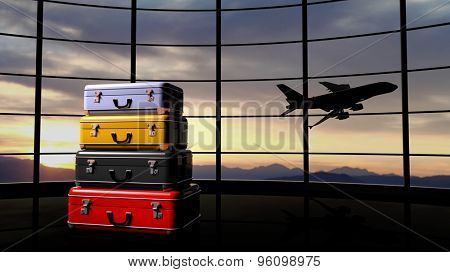 Stack of suitcases beside airpot window with sunset and airplane in flight