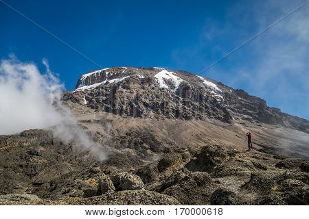 Tourist And Kibo Peak In Mount Kilimanjaro, Tanzania