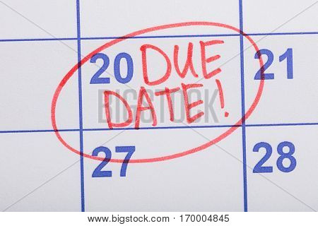 Close-up Of Red Circle Marked With Words Due Date Written On A Calendar