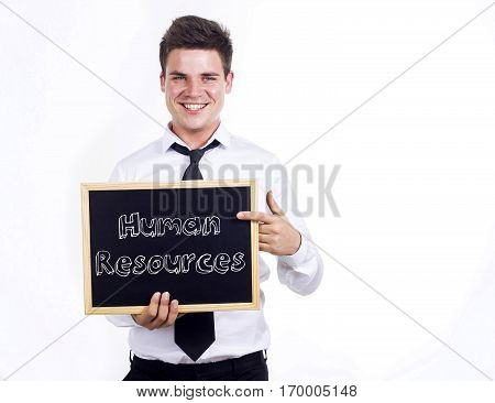 Human Resources - Young Smiling Businessman Holding Chalkboard With Text
