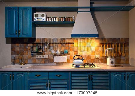 Kitchen with blue boiling kettle in the interior