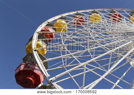 The colored ferris wheel with the blue sky