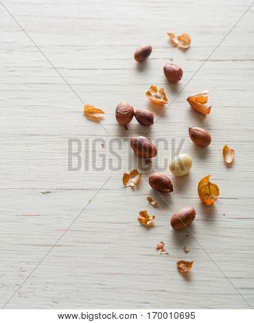 Fried Peanut On A White Wooden Background.