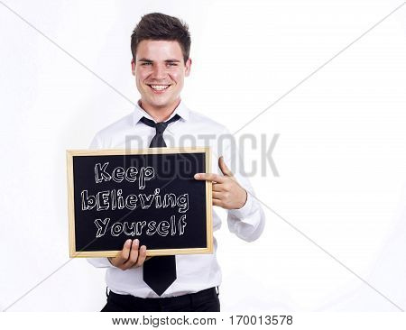 Keep Believing Yourself Key - Young Smiling Businessman Holding Chalkboard With Text