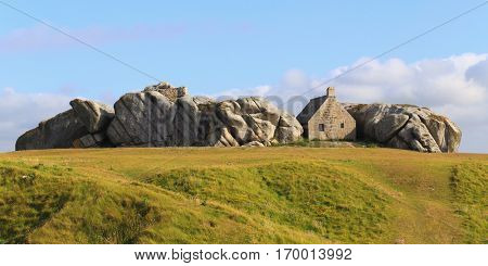 Little house inside the rocks in Meneham village, Kerlouan, Brittany, France