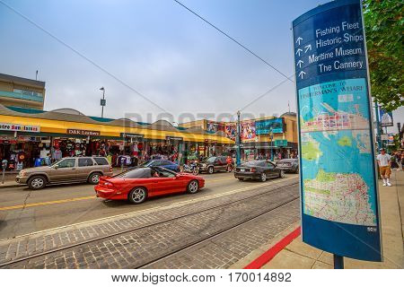 San Francisco, California, United States - August 14, 2016: Red sport car on Jefferson rd during the luxury cars street parade to Fisherman's Wharf waterfront. America travel tourism.