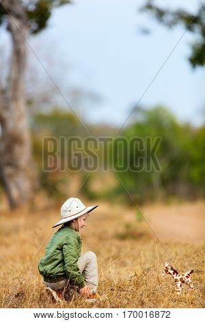 Adorable little girl in South Africa safari with giraffe toy