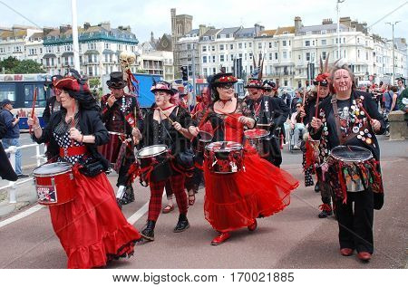 ST. LEONARDS-ON-SEA, ENGLAND - JULY 9, 2016: The Section 5 drummers parade along the seafront during the St. Leonards Festival. The annual music and entertainment event was first held in 2006.