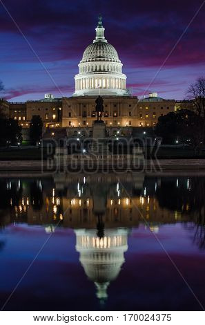 The Capitol Building with mirror reflection on the pool - Washington DC USA