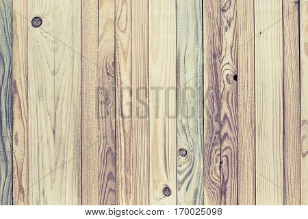 Light stylized decorative wood background from variety of narrow strips textured and with knots