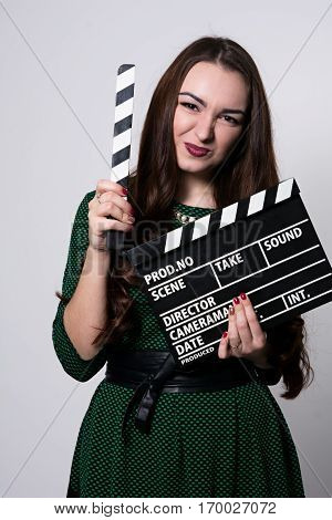 Beautiful Emotional Woman Holding A Movie Clapper