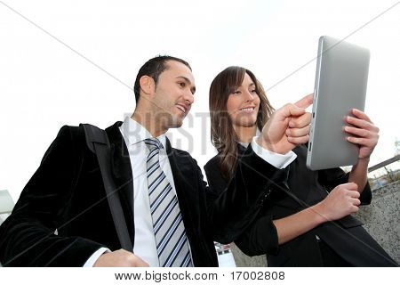 Business people meeting outside with electronic tablet