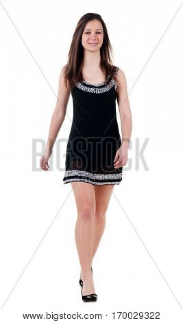 forward view of walking brunette woman  in black dress. beautiful smiling girl in motion. frontview of person. Isolated over white background. view people collection.
