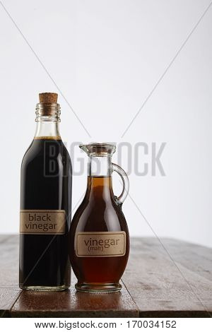 black and malt vinegar  on the wooden table top
