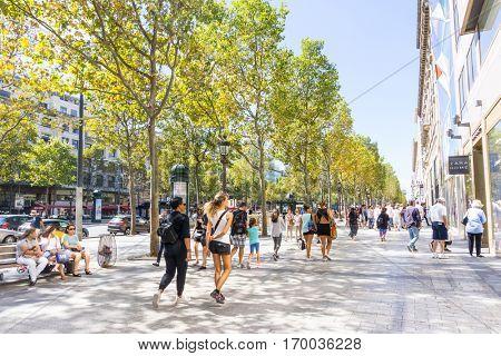 PARIS, FRANCE - August 28, 2016 : Tourists on foot Graben Street view around Paris city. Paris is the capital and most populous city of France.August 28, 2016, Paris, France.