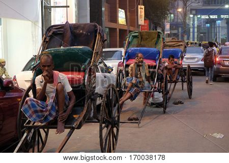 KOLKATA, INDIA - FEBRUARY 10: A hand rickshaw puller waits for passengers in his rickshaw in Kolkata on February 10, 2016.