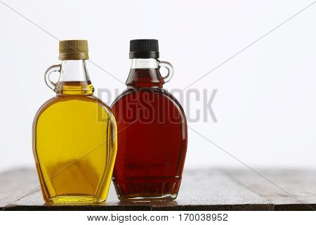 agave syrup and maple syrup side by side