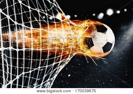 Professional soccer fireball leaves trails of flames and scores a goal on the net