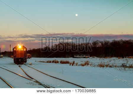 winter snow railway wagons freight train travels through the vast expanses of snow-covered