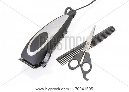 modern electric hair / beard trimmer with scissors and comb isolated on white background.