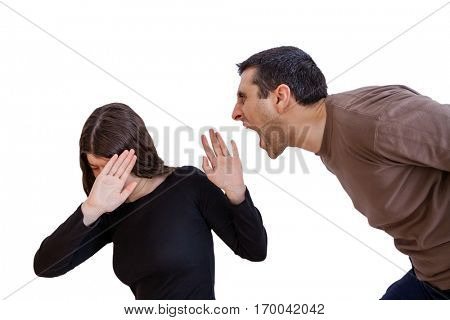 Domestic violence scene with a abusing husband or boyfriend shouting and yelling at his wife or girlfriend