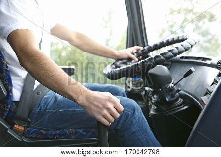 Hand of bus driver on gear lever