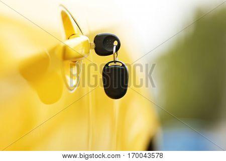 Key in car door lock, closeup