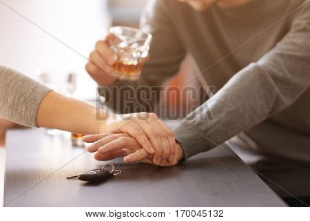 Woman preventing drunk man from taking car keys, closeup. Don't drink and drive concept