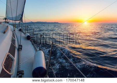 Sailing ship boats in the Sea during amazing sunset. Luxury yachts.