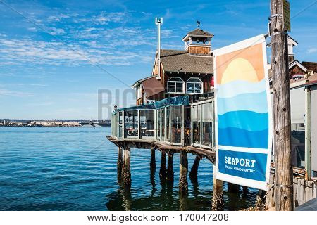 SAN DIEGO, CALIFORNIA - JANUARY 8, 2017:  Restaurant and banner at the Seaport Village tourist attraction, an entertainment, shopping and restaurant complex on the waterfront.