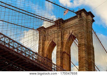 American flag on Brooklyn Bridge Brooklyn bridge with cloudy blue sky, New York