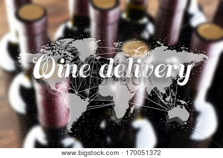Text WINE DELIVERY and world map on blurred wine bottles background