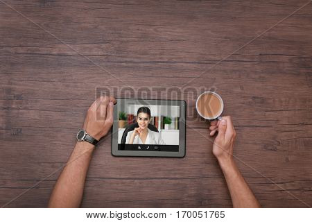 Man video conferencing with lawyer on tablet. Video call and online service concept.