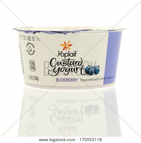 Winneconne WI -9 February 2017: Container of Yoplait custard yogurt in blueberry flavor on an isolated background.