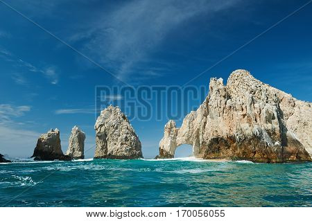 Sanny day in Cabo San Lucas tourist destination. Arch rock at clear green sea in Cabo San Lucas Mexico