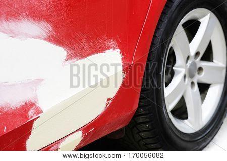 glazed body of a red car