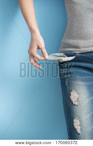 woman showing her empty pockets demonstrating her has no money