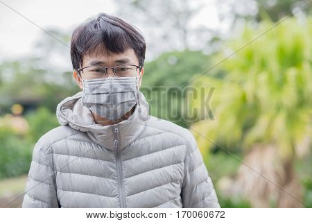 man get cold and wear mask asian
