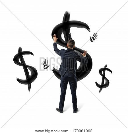 Businessmen on white background placing hands on black painted dollar signs and hand prints. Business and finance. Oil and gas industry. Money and banking.