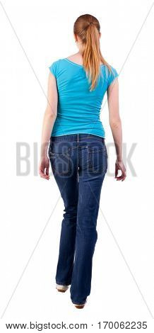 back view of walking  woman  in   jeans and shirt. beautiful blonde girl in motion.  backside view of person.   Isolated over white background. blonde teen boldly steps forward to own goals