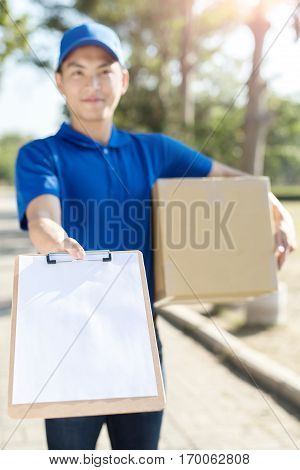 deliveryman take cardboard and smile to youasian