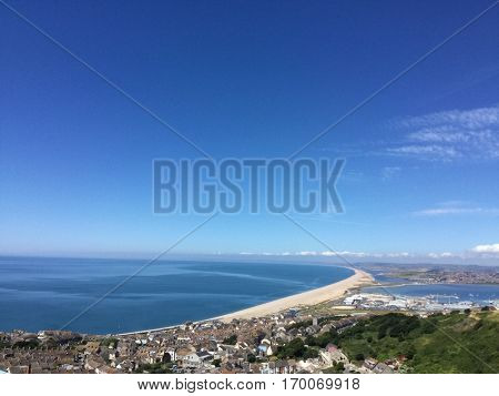 Portland town UK with views of Chesil Beach and the harbour in the distance. The harbour is the second largest man made harbour in the world and the largest in Europe.