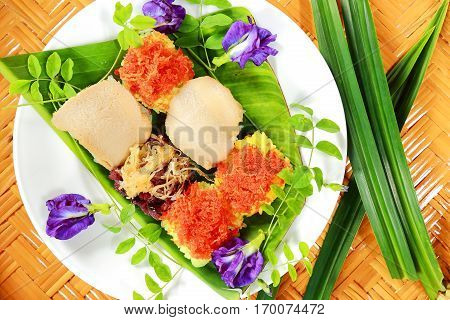 Thai dessert Sticky Rice with various Topping on banana leaf.