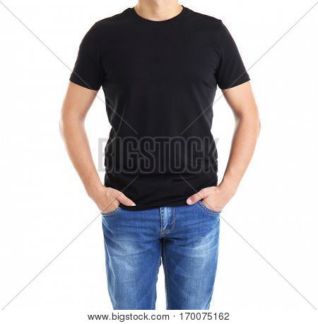 Handsome young man in blank black t-shirt on white background, close up