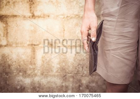 Close up of man's hand holding a empty black wallet