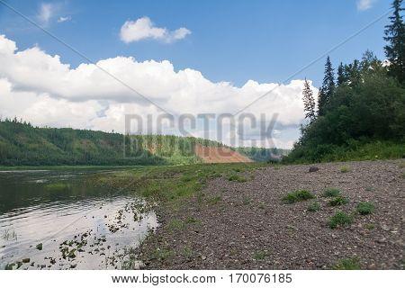 The sandy bank of the river. Affluent of Yenisey river. Krasnoyarsk Territory.