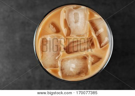 Iced coffee with milk on grey background